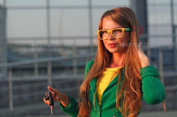 Girl holding car keys - Stock Photo - Images Download here : https://photodune.net/item/girl-holding-car-keys/17936495?s_rank=326&ref=Al-fatih