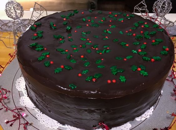 Looking for a fabulous dessert for your holiday party? Then look no further! Festive red, white and green layers of almond cake are spread with raspberry jam and doused in a rich chocolate glaze. L...