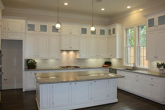 stacked cabinets; like frosted glass and crown molding ...