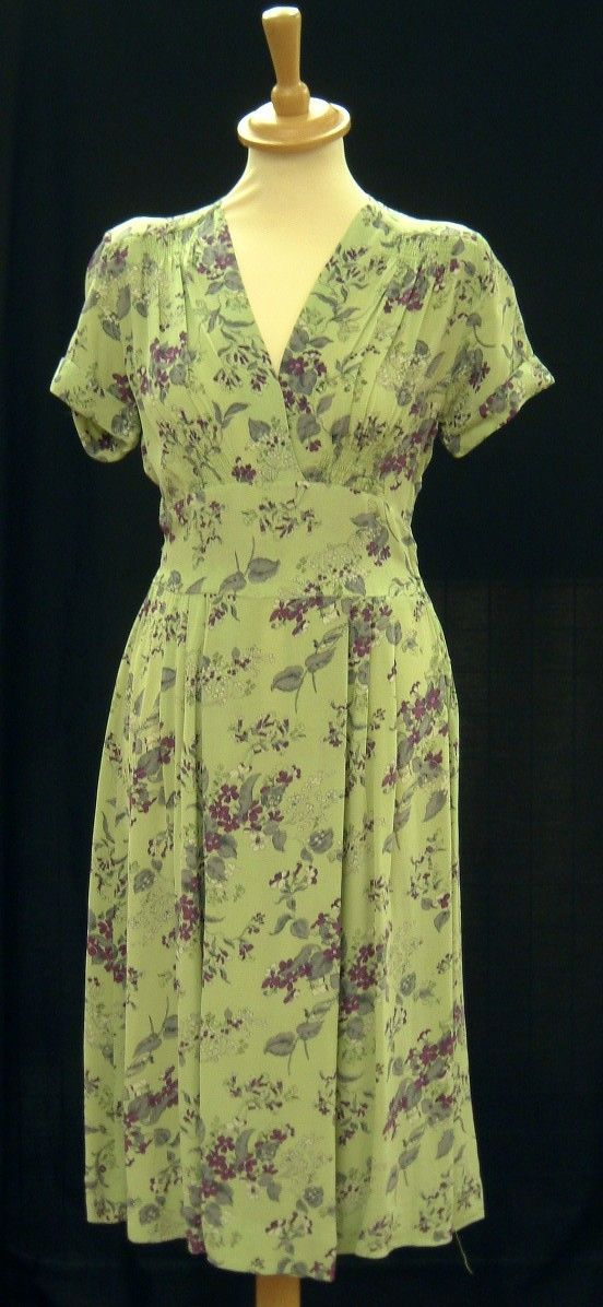 Green rayon crepe Utility Wear dress from Marks & Spencer, 1940s. Clothes rationing started in June 1941 and M worked hard to provide clothing that conformed with the CC41 regulations, but that was also well designed and attractive. © M Company Archive