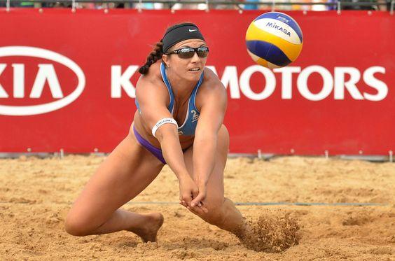 USA's Misty May-Treanor lifts the ball to teammate Kerri Walsh