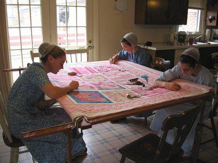 Mennonite girls I'm guessing. Beautiful quiltwork!