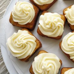 Mini banana cakes with cream cheese frosting.