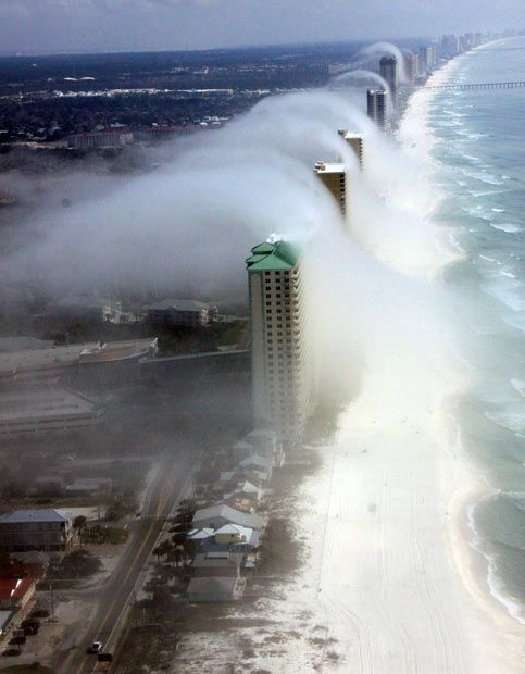 Thick fog creates a 'tsunami' of wave clouds on a beach in Florida, US. The phenomenon was snapped by pilot JR Hott