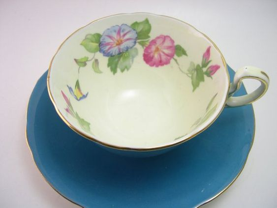 Very nice tea cup and saucer from Aynsley Turquoise with a beautiful border of pink and blue flowers. The backstamp date this cup 1939+ Cup Measures: 2 1/8 high & Saucer Measures 5 5/8 diameter Very good conditon, no chips, no cracks but some tiny white marks as shown on picture