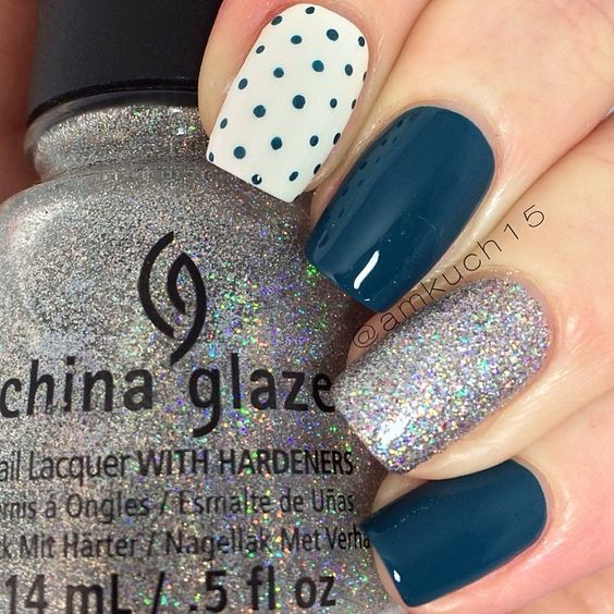 Navy/teal blue creme, white base with blue dots, and one accent nail of China…