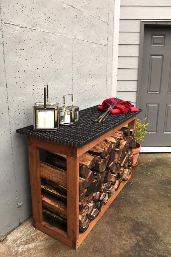 firewood storage with an outdoor surface designed for serving food #fireWoodStorage #firewoodrack #firewood #firewoodideas #organization #outdoorFurniture #backyardFurniture #patioFurniture