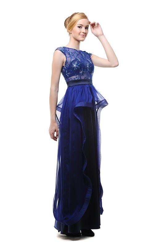 Вечернее платье с гипюровым верхом и расклешенной юбкой. Юбка декорирована фатиновым воланом и с шелковыми лентами.