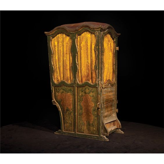Antique wooden sedan chair in the French Revolutionary style