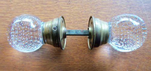 Antique bubble ball glass doorknobs.