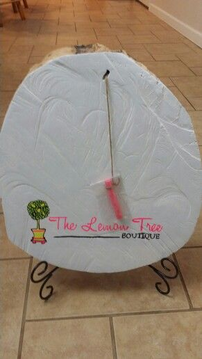 Wooden log slice turned into a chalkboard... homemade chalkboard paint...transfer image with chalke and use paint markers to trace image...tie a piece of chalk...voilà ! I made this for my friends boutique :)  Dana Childress