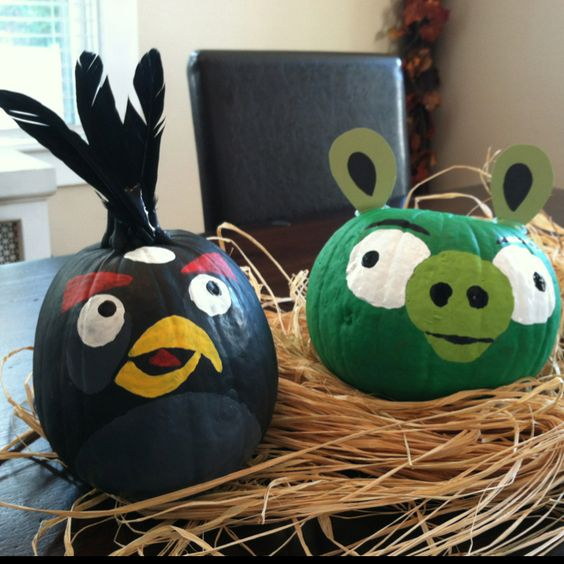 Angry Bird Pig and Black Bird, Dair painted the entire pumpkins green and black and Mama painted the faces