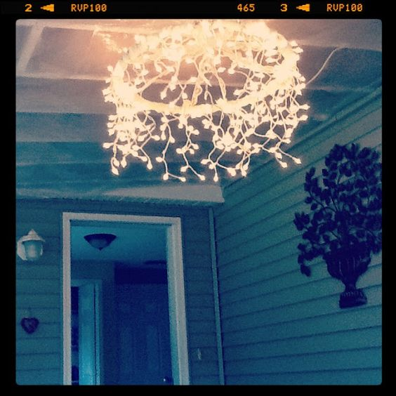 What kind of light element can you make with a hula hoop, some lace, a glue gun, and some icicle white lights? A sweet Hula Hoop Chandelier!!