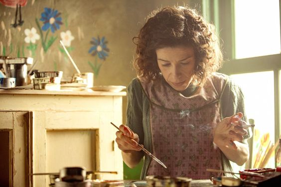 """Sally Hawkins as Maud Lewis in the 2016 film, """"Maudie"""", Directed by Aisling Walsh.  With Ethan Hawke, Sally Hawkins, Kari Matchett, Gabrielle Rose. An arthritic Nova Scotia woman works as a housekeeper while she hones her skills as an artist and eventually becomes a beloved figure in the community."""