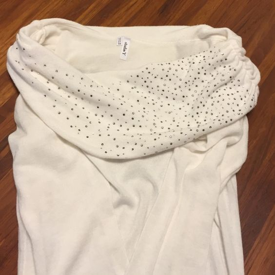 Sweater This glamorous sweater can be worn in multiple ways it can be off shoulder a dress or a long sweater best to wear with leggings thin and stretchy material Maurices Sweaters