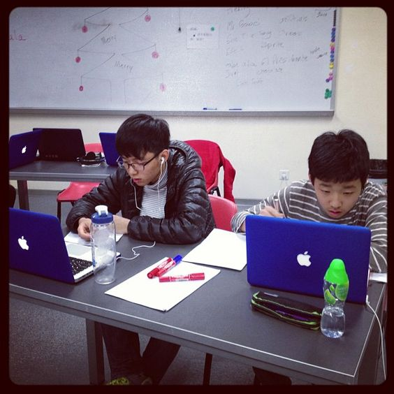 Photo by meaganpavey - China - Students preparing arguments for the @eracismproject finals on Wednesday  December 19 - the students in China were in school at 9:30 pm and the US arrived at 7;30 am.
