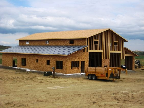 Horse barns with living quarters framing up two story for Shop with living quarters