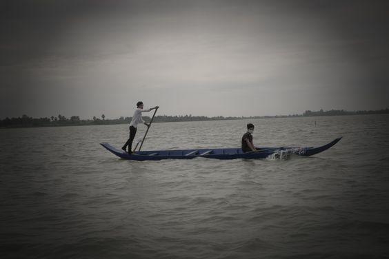 Man Rowing boat, taken in Tonle Bati, Takeo, Cambodia