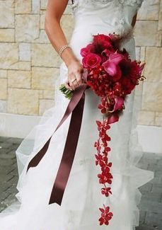 BOUQUET STYLE: hand-tied with cascading burgundy orchids
