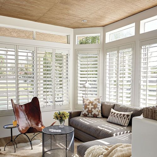 Shutters in sunroom, sectional sofa