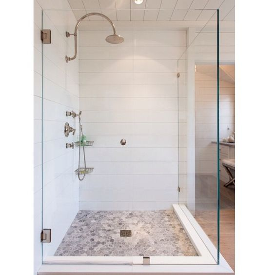 Planked white wall in shower from scored Corian. Yes!!!
