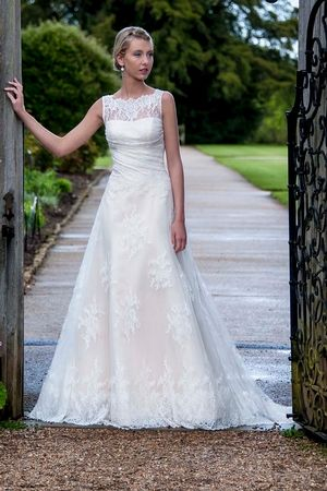 Augusta Jones Bateau A-Line Gown in Lace This a-line gown features a bateau neckline with in lace. It has a chapel train and a tank top.   Style Number:32862666 Price:$ ($2000 - $3000)