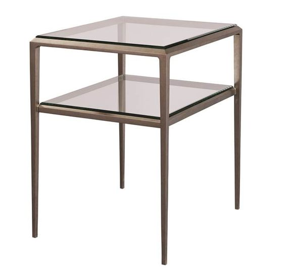 Ancel Side Table This is a wonderful aged nickel plated silver and glass side table.  The clean and simple design of this table allows it to work in numerous settings – formal to relaxed. The aged silver finish expands Ancel's ability to fit in more modern and contemporary spaces while still adhering to the classic  Parisian design influences.