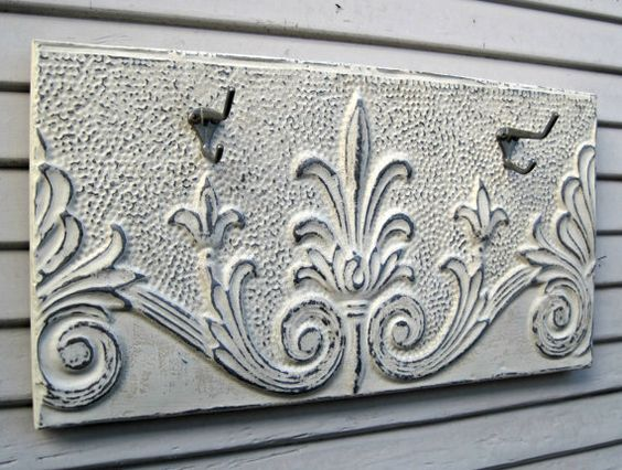 This antique ceiling tin has such wonderful vintage character. Salvaged many years ago in the New England region, the tin is in fantastic condition. We have painted the tin a soft pretty off-white and sealed it with a clear matte sealer. We buffed the tin to bring out the gorgeous pattern and patina of the old metal.  The 2 antique coat hooks were salvaged from an old house.