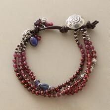 Rich in colorful detail, this multi-strand garnet bracelet makes a sumptuous impression.