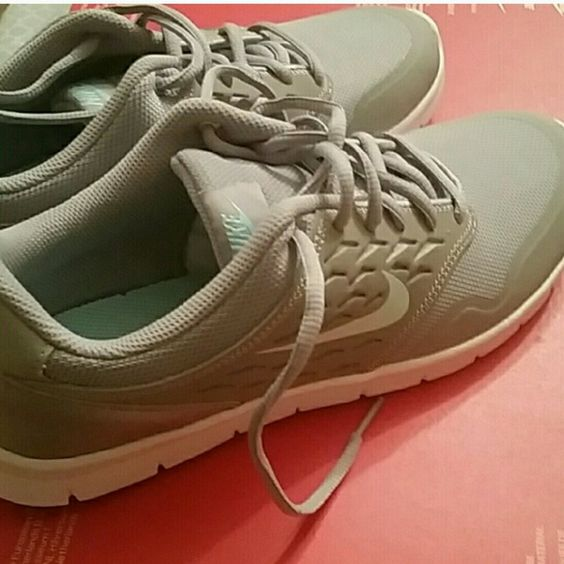 New! Nike Orive shoes size 9.5 Brand new in box.  Size 9.5 Gray with a mint green accent. Nike Shoes Athletic Shoes