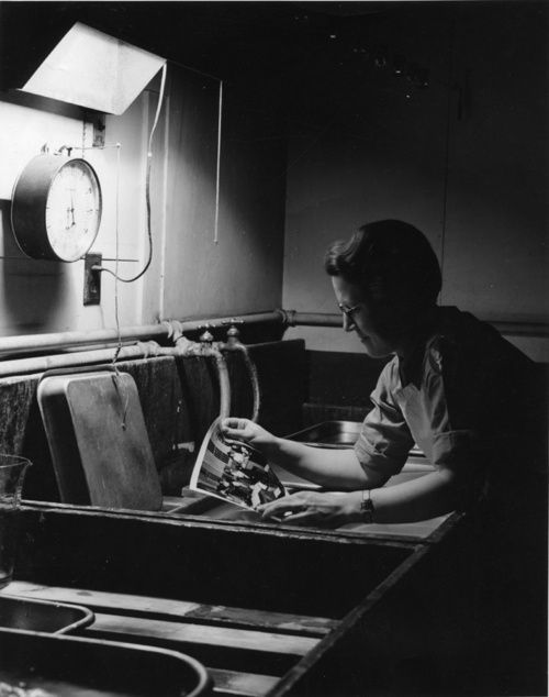 Fairfield: Pvt. Elsie P. Boness, 32, of Whiting, Indiana, works in the Photographic Laboratory Photographer unknown.