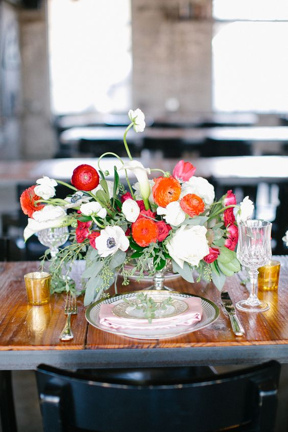 LOVE LOVE LOVE the shape and colors here!!! I don't know if poppies will be in season, but I do love the ranunculus, and with garden roses, marigolds, etc as we discussed, I'd say this is my ideal centerpiece.