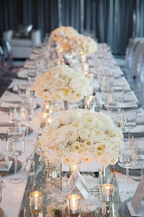 White Roses Are So Beautiful That They Look Gorgeous All On Their Own No Filler Flow Winter Wedding Centerpieces Winter Wedding Table Low Wedding Centerpieces
