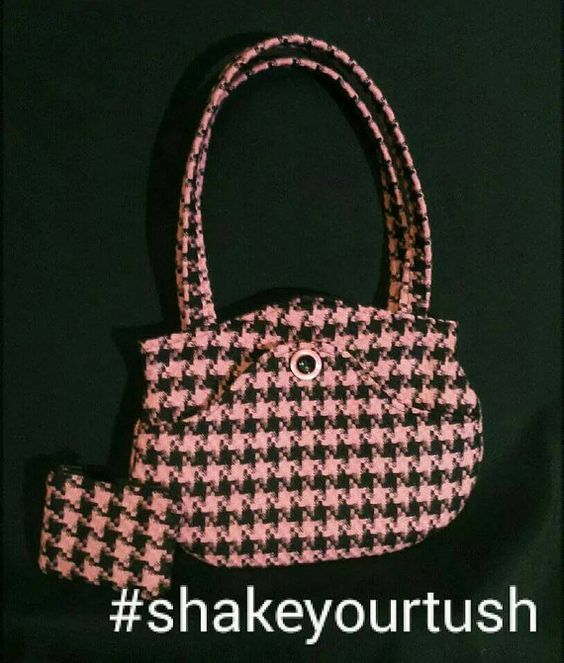 Check out this item in my Etsy shop https://www.etsy.com/uk/listing/211036340/pink-and-black-fifties-style-houndstooth