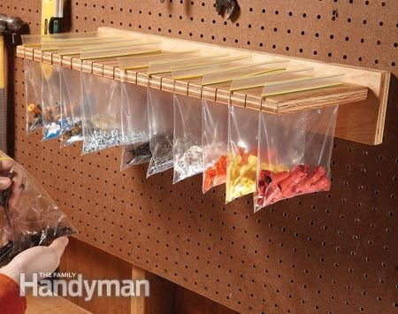 Small parts storage Cut slots in a piece of plywood with a jigsaw. Fill resealable bags with small parts, hardware or craft items and hang them from the slotted plywood.: