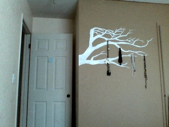 Painted my bedroom wall brown with a white tree branch to contrast the color. What do you guys think?