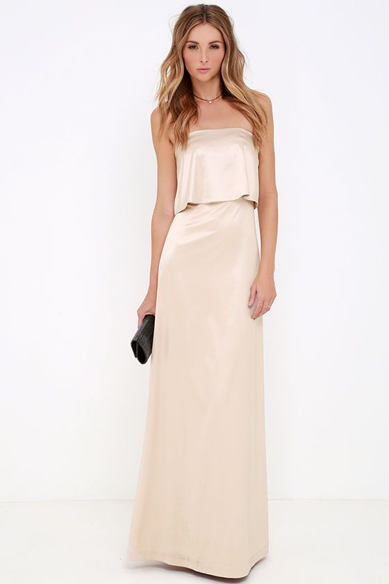 Perfect for any formal occasion, the Ever So Lovely Beige Satin Maxi Dress has an unmatched elegance! Sleek and stretchy satin knit falls from a strapless neckline (with no-slip strips) to a fluttering flounce that parts at back. Body-skimming skirt ends at a maxi length. Hidden back zipper with clasp.