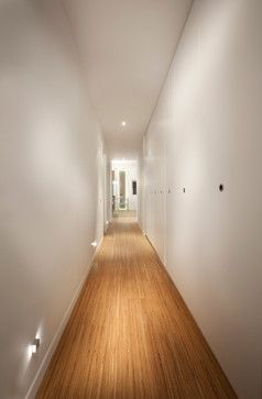 love the simple, soft but highly effective lighting in this long narrow hallway.  With a dimmer you've got nightlights, too.: