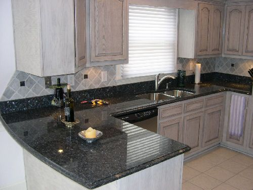 grey cabinets with blue pearl granite counter. Maybe with a ...