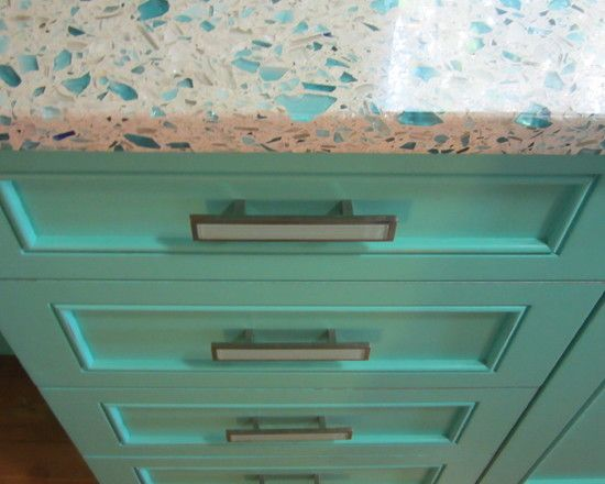 Gorgeous recycled glass counter with sea glass and turquoise cabinets