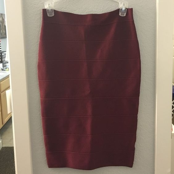 Maroon Pencil Skirt Gorgeous Martin colored skirt. Super tight fitting. Never worn with original tags. Romeo & Juliet Couture Skirts Pencil