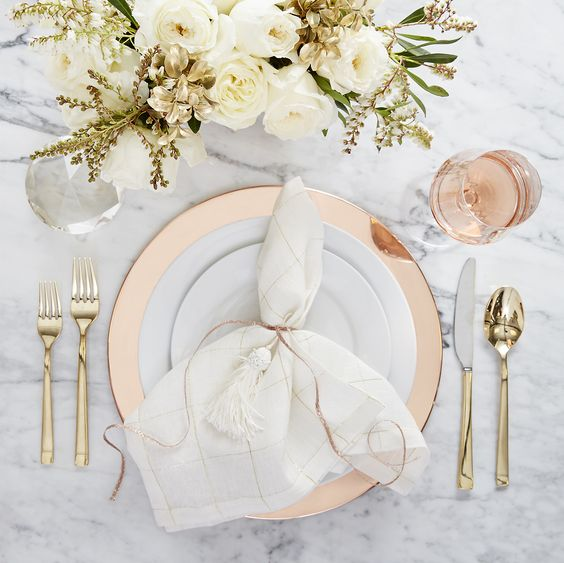 Add a touch of glam to your home decor with copper and gold hues that will warm up any table setting.: