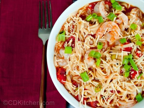 Shrimp and cooked pasta are tossed with a slowly simmered, well seasoned tomato sauce to make this delicious meal. | CDKitchen.com