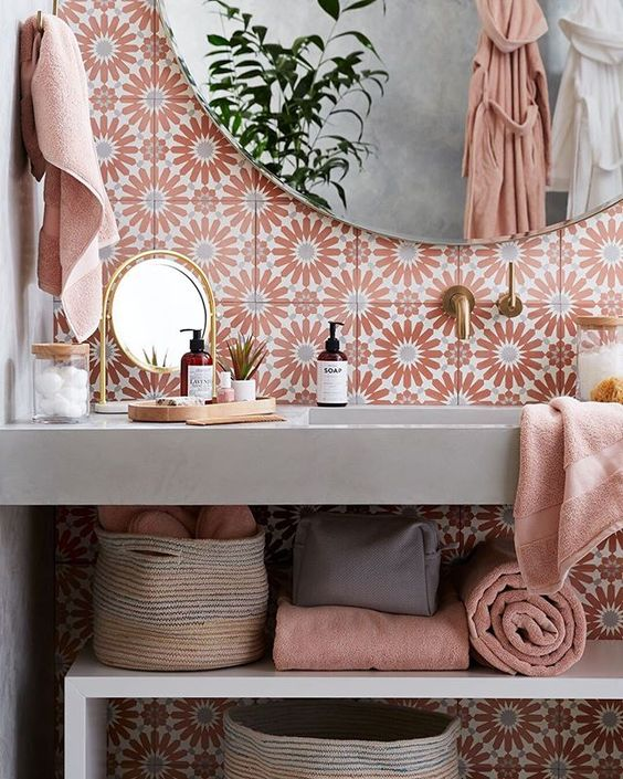 We blushed four shades of pink when we saw this bathroom filled with beautiful Turkish cotton towels, brass mirrors and wood accents. What's your ideal bathroom look like? #CrateStyle #BathroomDesign #BlushTones #Interiors