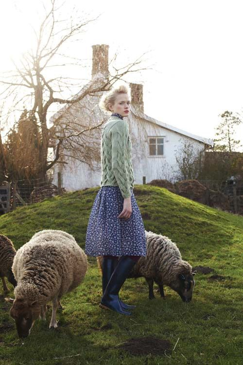 Love the green sweater with the blue dress.  I want to be the one in this picture.