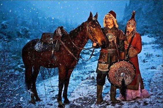 Kyrgyz couple in historical costumes.: