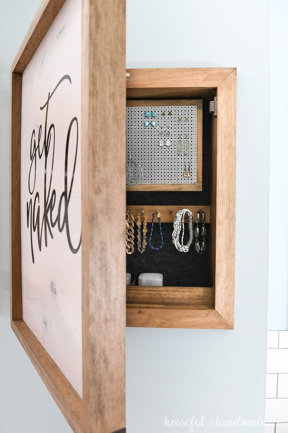 Organize and hide all your jewelry with this beautiful DIY wall jewelry organizer. The front of the jewelry cabinet is a modern wood sign that you can put any design on. And the inside is full of organization for necklaces, earrings, bracelets and more. Housefulofhandmade.com | #jewelry #organizer #woodworking #buildplans