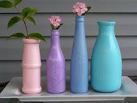 painted glass bottles used as flower vases