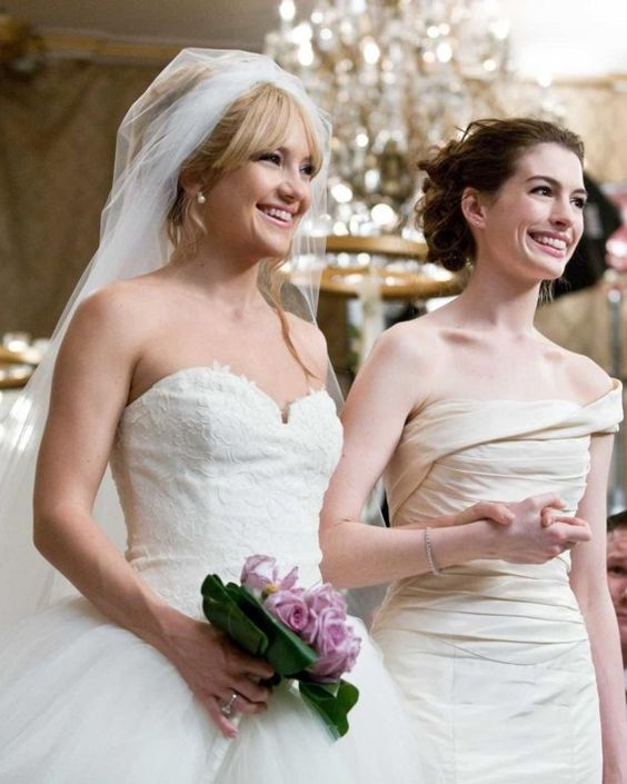 Both besties-turned-enemies were outfitted in Vera Wang dresses for their weddings in the 2009 comedy: Liv (Kate Hudson) in a sweetheart tulle ball gown with a lavender sash and Emma (Anne Hathaway) in an ivory fit-and-flare.