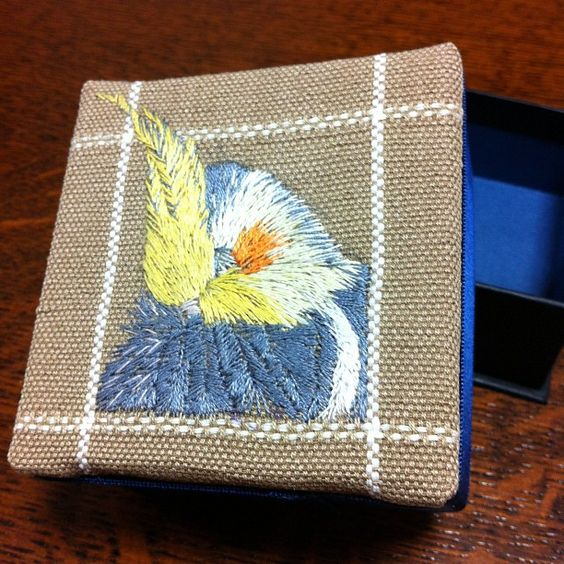 "AWESOME - Twitter / @jfworld ""My wife made an accessory case with an embroidered portrait of Pikuo the cockatiel."""